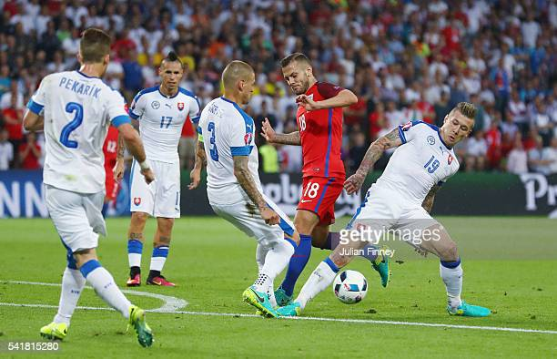 Jack Wilshire of England competes for the ball against Martin Skrtel and Juraj Kucka of Slovakia during the UEFA EURO 2016 Group B match between...