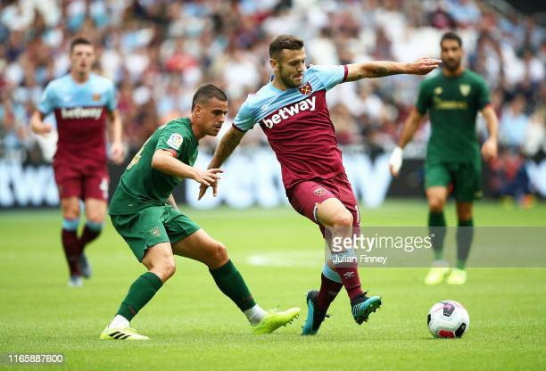 Jack Wilshire of West Ham holds off Dani Garcia of Bilbao during the PreSeason Friendly match between West Ham United and Athletic Bilbao at the...