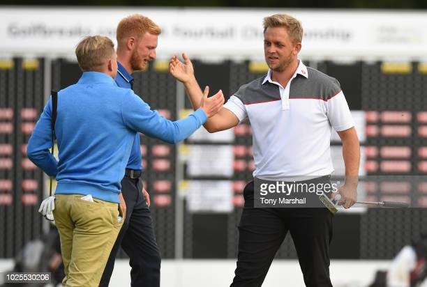 Jack Winer of Abridge Golf Country Club and James Watts of Kingsway Golf Centre celebrate winning on the second play off hole on the 18th green...