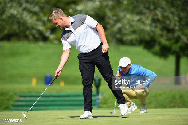 Jack Winer of Abridge Golf Country Club points out the line as James Watts of Kingsway Golf Centre lines up a putt on the 9th green during the final...