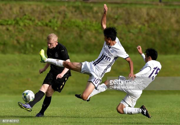 Jack Young of Newcastle United and Atsuya Ikema and Sota Kobayashi of Komazawa University FC during the Super Cup NI u18 tournament group game...