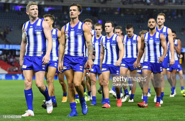Jack Ziebell and his Kangaroos team mates look dejected after losing the round 3 AFL match between the North Melbourne Kangaroos and the Western...