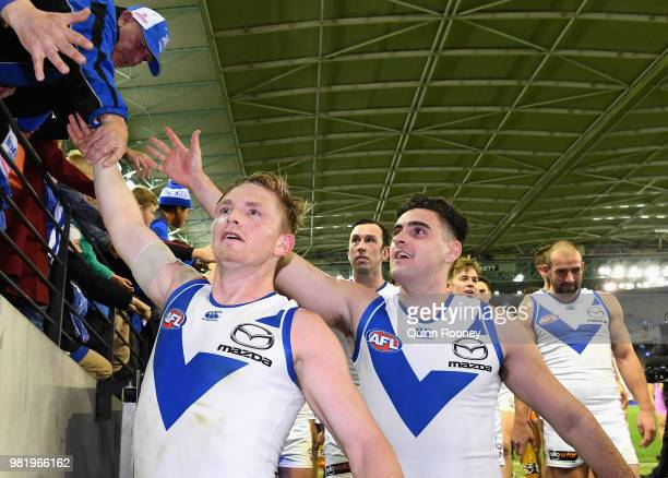 Jack Ziebell and Paul Ahern of the Kangaroos high five fans after winning the round 14 AFL match between the Western Bulldogs and the North Melbourne...