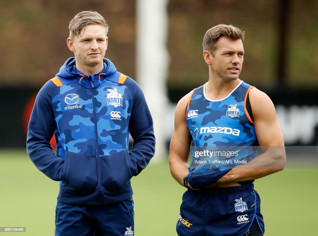 Jack Ziebell (left) and Shaun Higgins of the Kangaroos look on during the North Melbourne Kangaroos training session at Arden St on December 4, 2017 in Melbourne, Australia.