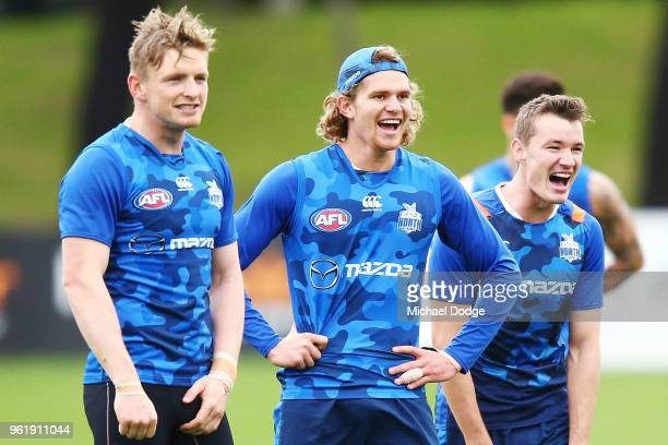 Jack Ziebell Jed Anderson and Kayne Turner react during the North Melbourne Kangaroos AFL training session at Arden Street Ground on May 24 2018 in...