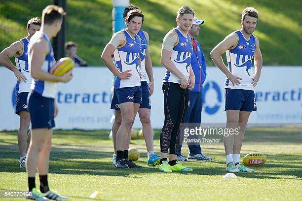 Jack Ziebell jokes with Aaron Mullett during a North Melbourne Kangaroos AFL training session at Arden Street Ground on June 15 2016 in Melbourne...