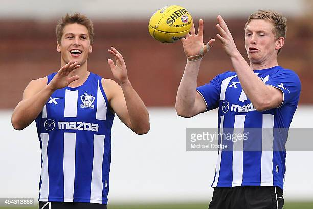 Jack Ziebell marks the ball next to Andrew Swallow during a North Melbourne Kangaroos AFL training session at Arden Street Ground on August 29 2014...