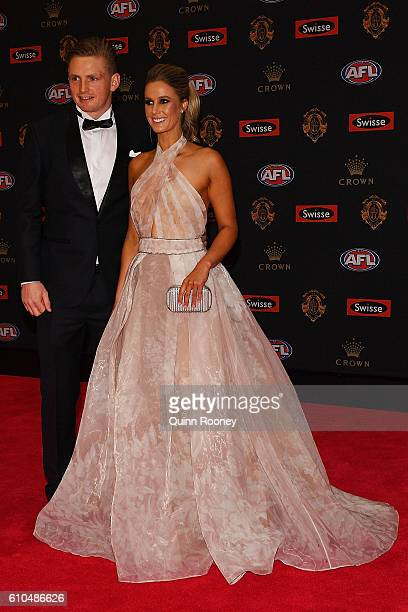 Jack Ziebell of North Melbourne and partner Linda Weatherlake arrive ahead of the 2016 Brownlow Medal at Crown Entertainment Complex on September 26...