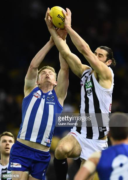 Jack Ziebell of the Kangaroos and Brodie Grundy of the Magpies compete for a mark during the round 20 AFL match between the North Melbourne Kangaroos...