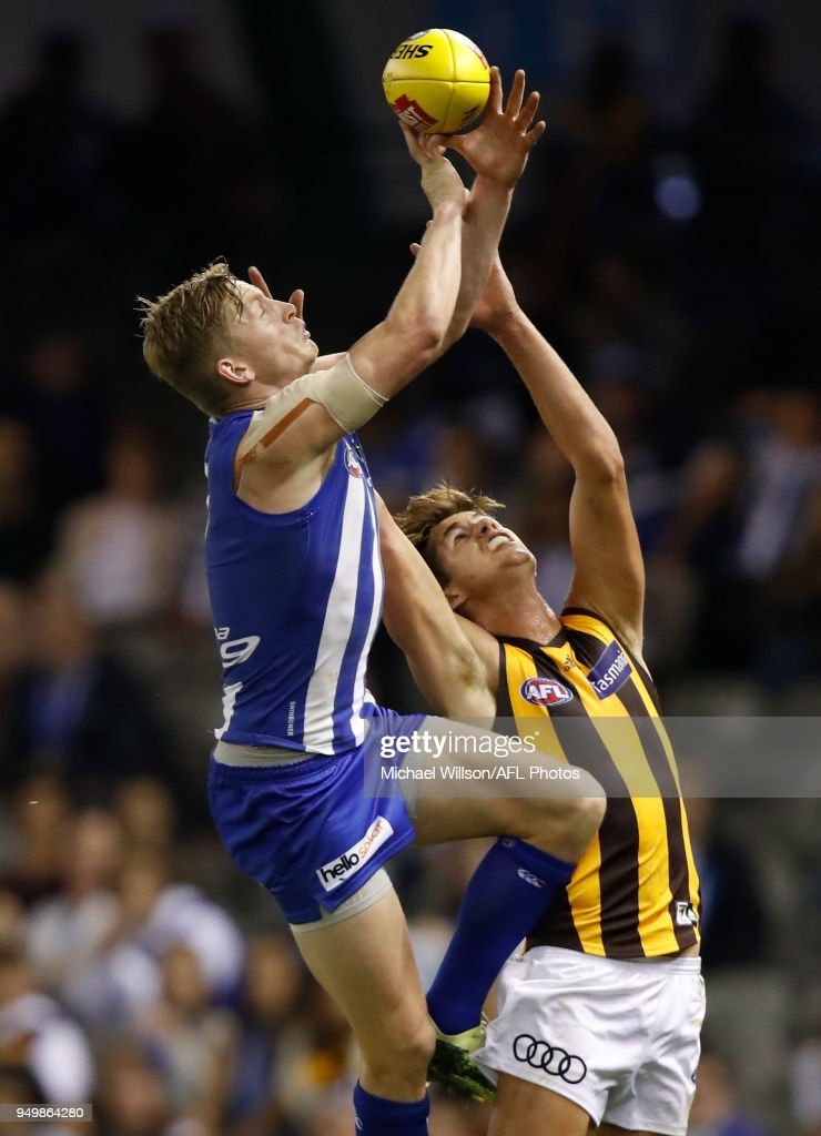 Jack Ziebell of the Kangaroos and Daniel Howe of the Hawks compete for the ball during the 2018 AFL round five match between the North Melbourne Kangaroos and the Hawthorn Hawks at Etihad Stadium on April 22, 2018 in Melbourne, Australia.