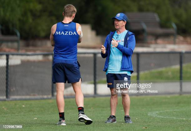 Jack Ziebell of the Kangaroos and David Noble, Senior Coach of the Kangaroos share a conversation in action during the North Melbourne Kangaroos...