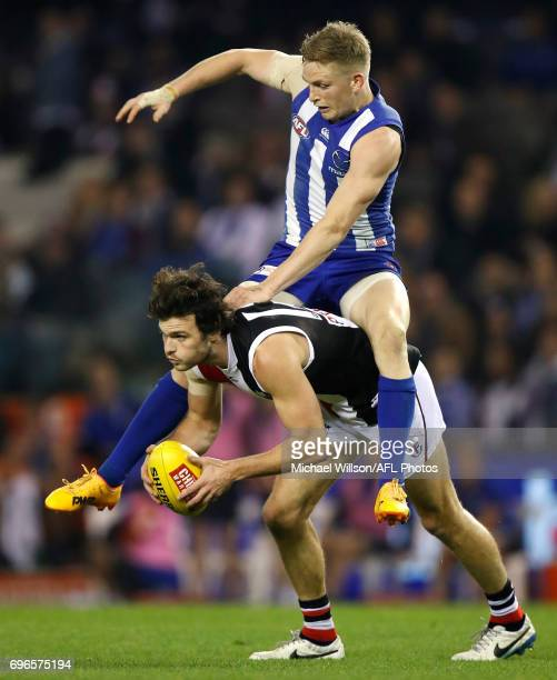 Jack Ziebell of the Kangaroos and Dylan Roberton of the Saints compete for the ball during the 2017 AFL round 13 match between the North Melbourne...