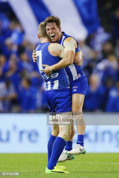 Jack Ziebell of the Kangaroos and Nathan Hrovat of the Kangaroos celebrates the win on the final siren during the round six AFL match between the...