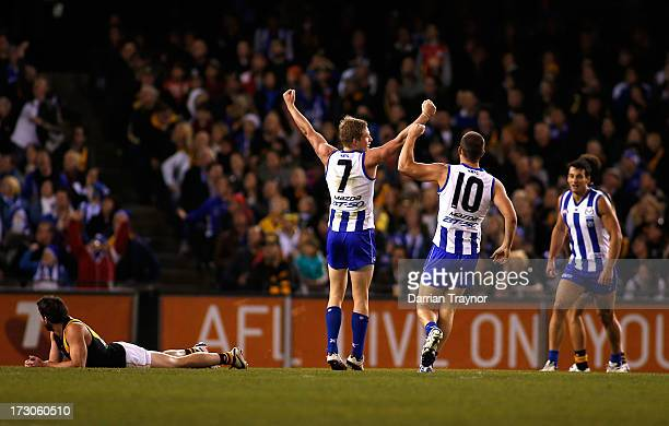 Jack Ziebell of the Kangaroos celebrates a goal during the round 15 AFL match between the North Melbourne Kangaroos and the Richmond Tigers at Etihad...