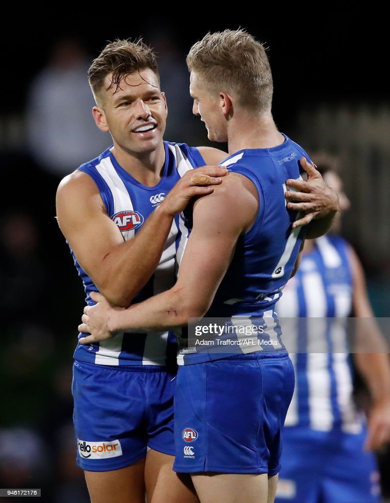 Jack Ziebell of the Kangaroos (right) celebrates a goal with Shaun Higgins of the Kangaroos during the 2018 AFL Round 04 match between the North Melbourne Kangaroos and the Carlton Blues at Blundstone Arena on April 14, 2018 in Hobart, Australia.