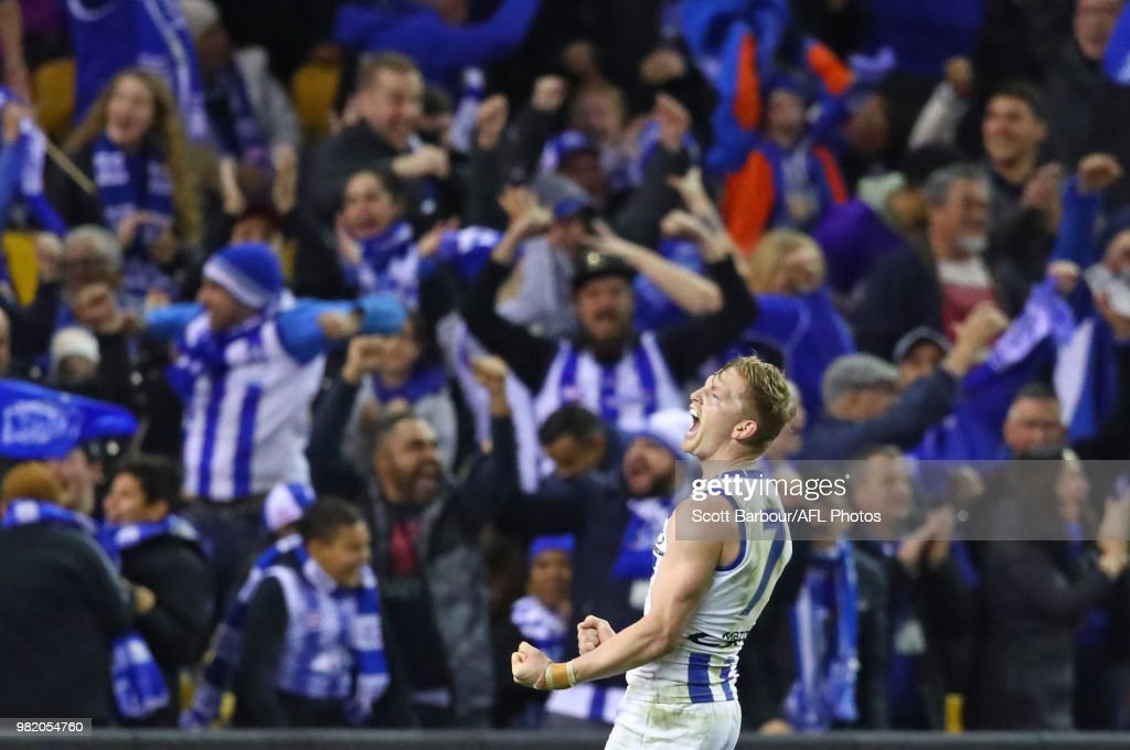 Jack Ziebell of the Kangaroos celebrates after kicking the match winning goal during the round 14 AFL match between the Western Bulldogs and the North Melbourne Kangaroos at Etihad Stadium on June 23, 2018 in Melbourne, Australia.