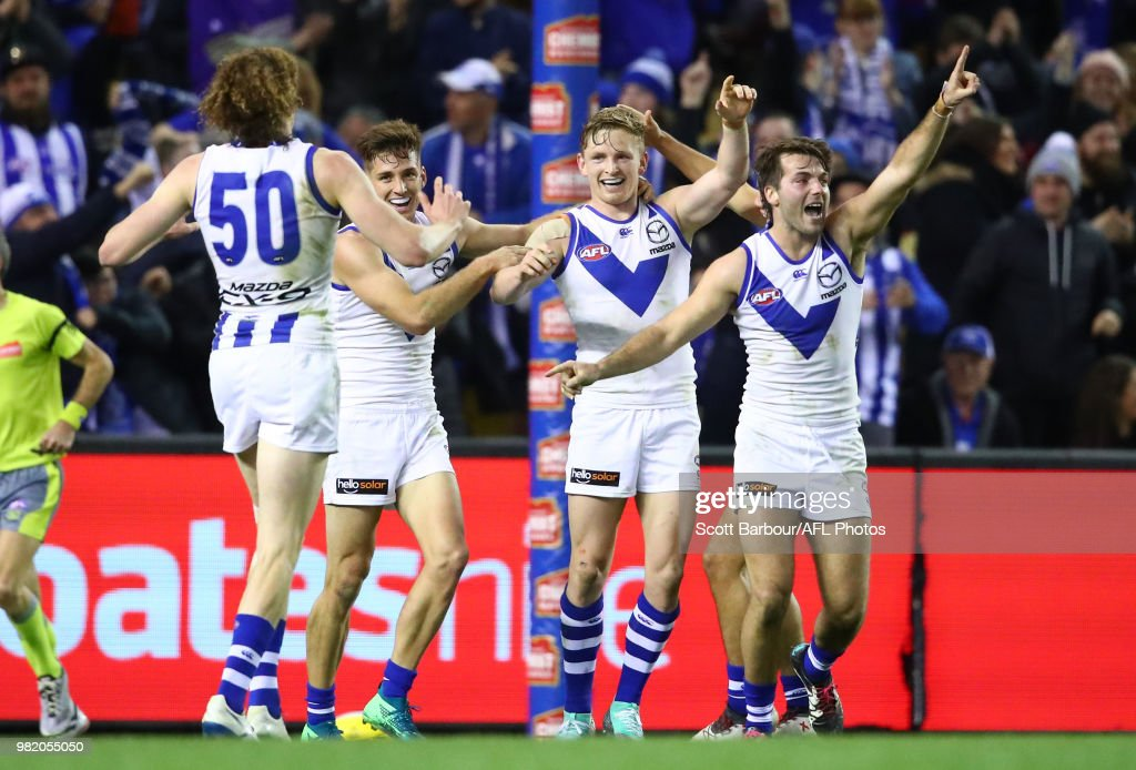 Jack Ziebell of the Kangaroos celebrates with Shaun Atley of the Kangaroos after kicking the match winning goal during the round 14 AFL match between the Western Bulldogs and the North Melbourne Kangaroos at Etihad Stadium on June 23, 2018 in Melbourne, Australia.