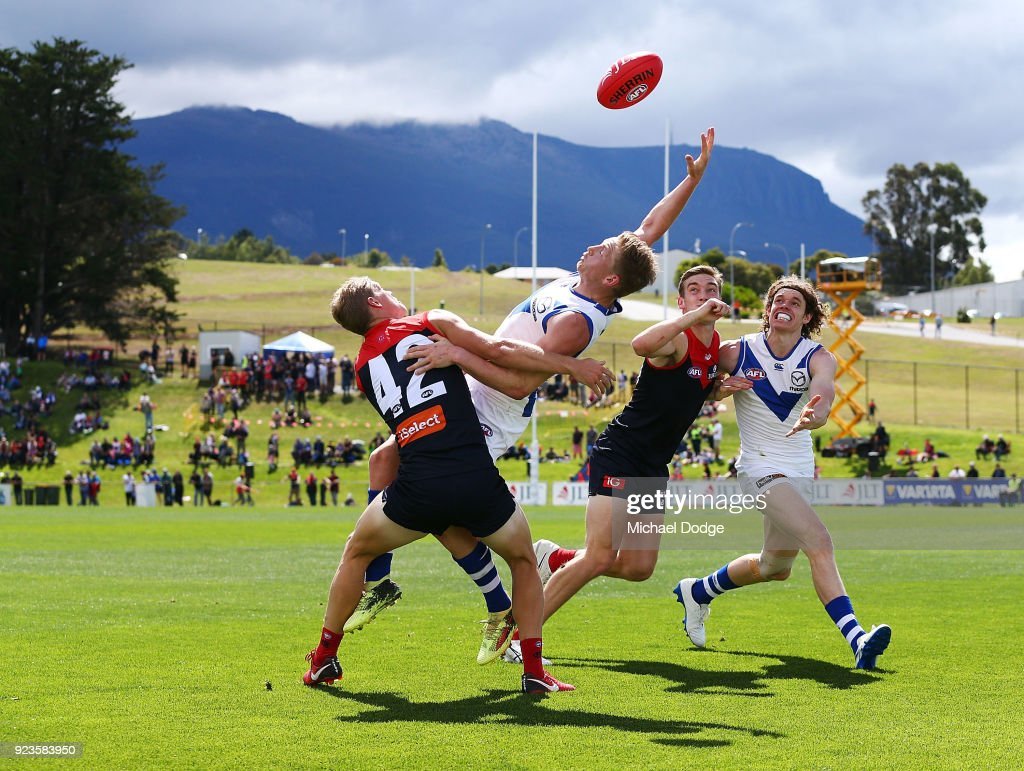 Jack Ziebell of the Kangaroos compete for the ball against Corey Maynard of the Demons (L) in front of Mount Wellington as a back drop during the JLT Community Series AFL match between the North Melbourne Kangaroos and the Melbourne Demons at Blundstone Arena on February 24, 2018 in Hobart, Australia.
