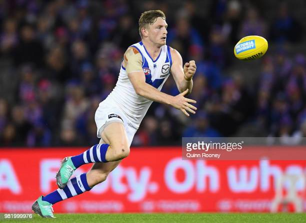 Jack Ziebell of the Kangaroos handballs during the round 14 AFL match between the Western Bulldogs and the North Melbourne Kangaroos at Etihad...