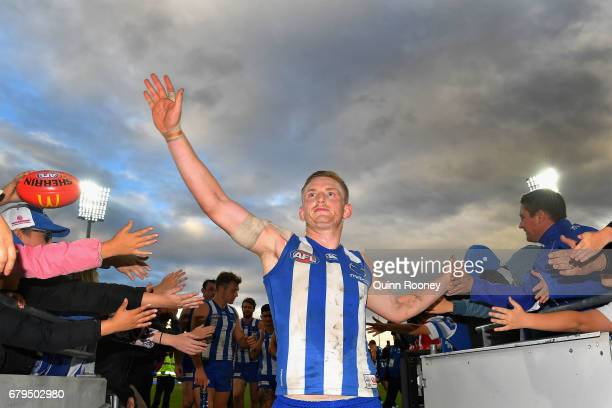 Jack Ziebell of the Kangaroos high fives fans after winning the round seven AFL match between the North Melbourne Kangaroos and the Adelaide Crows at...