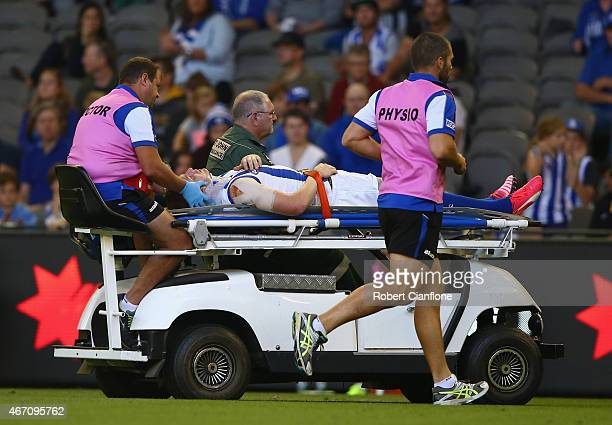 Jack Ziebell of the Kangaroos is taken from the ground after he was knocked out during the NAB Challenge AFL match between the Richmond Tigers and...
