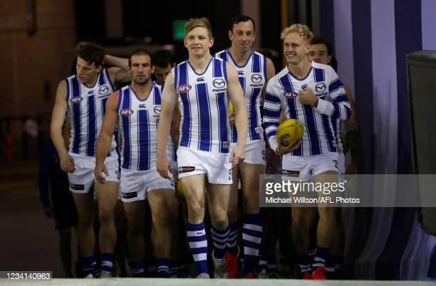 Jack Ziebell of the Kangaroos leads his team up the race during the 2021 AFL Round 19 match between the Carlton Blues and the North Melbourne...