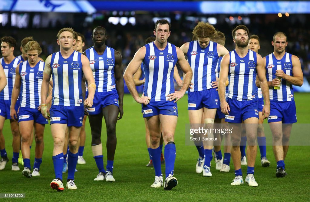 Jack Ziebell of the Kangaroos, Majak Daw of the Kangaroos, Todd Goldstein of the Kangaroos leave the field with their teammates after losing the round 16 AFL match between the North Melbourne Kangaroos and the Fremantle Dockers at Etihad Stadium on July 9, 2017 in Melbourne, Australia.