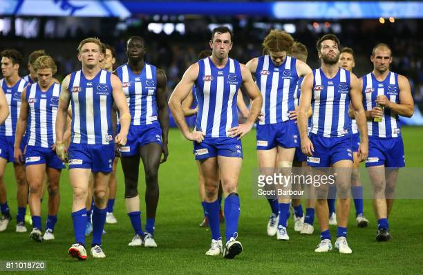 Jack Ziebell of the Kangaroos Majak Daw of the Kangaroos Todd Goldstein of the Kangaroos leave the field with their teammates after losing the round...