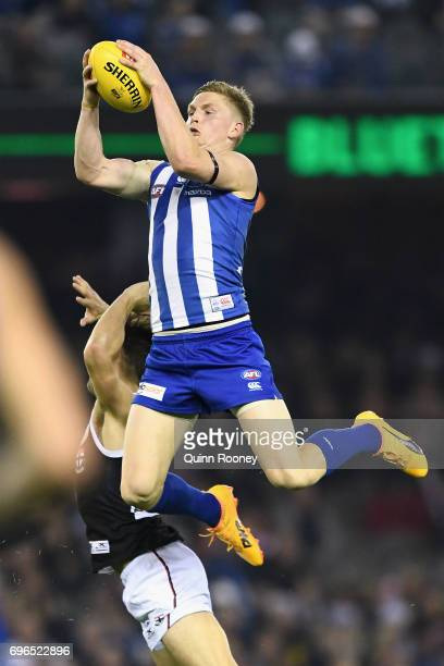 Jack Ziebell of the Kangaroos marks over the top of Koby Stevens of the Saints during the round 13 AFL match between the North Melbourne Kangaroos...