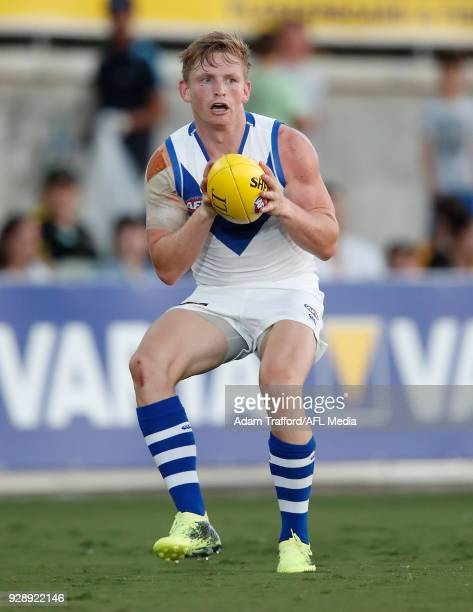 Jack Ziebell of the Kangaroos marks the ball during the AFL 2018 JLT Community Series match between the Richmond Tigers and the North Melbourne...