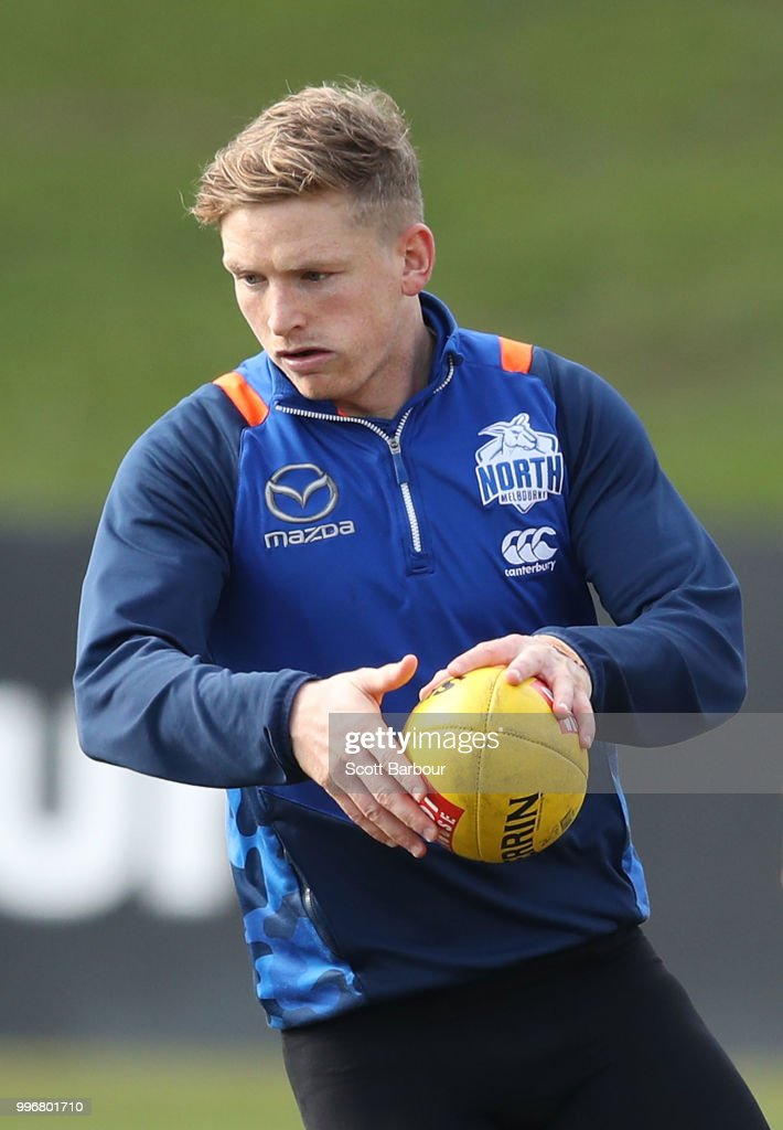 Jack Ziebell of the Kangaroos runs with the ball during a North Melbourne Kangaroos Training Session on July 12, 2018 in Melbourne, Australia.