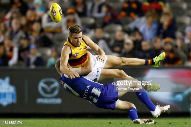 Jack Ziebell of the Kangaroos tackles Paul Seedsman of the Crows during the round four AFL match between the North Melbourne Kangaroos and the...