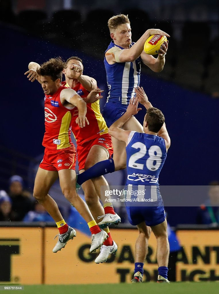 Jack Ziebell of the Kangaroos takes a strong mark over Jarrod Harbrow (left) and Steven May of the Suns and Kayne Turner of the Kangaroos during the 2018 AFL round 16 match between the North Melbourne Kangaroos and the Gold Coast Suns at Etihad Stadium on July 08, 2018 in Melbourne, Australia.