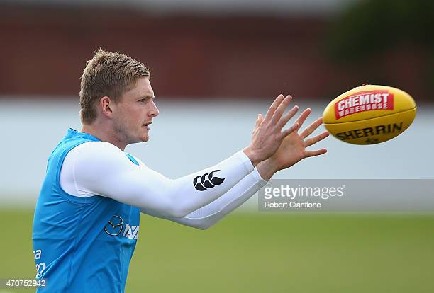 Jack Ziebell of the Kangaroos takes the ball during a North Melbourne Kangaroos AFL training session at Arden Street Ground on April 23, 2015 in...