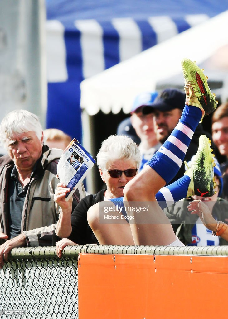 Jack Ziebell of the Kangaroos tumbles over the fence during the JLT Community Series AFL match between the North Melbourne Kangaroos and the Melbourne Demons at Blundstone Arena on February 24, 2018 in Hobart, Australia.