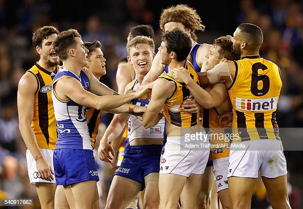 Jack Ziebell of the Kangaroos wrestles with Isaac Smith of the Hawks during the 2016 AFL Round 13 match between the North Melbourne Kangaroos and the...