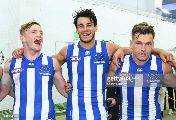 Jack Ziebell Robbie Tarrant and Shaun Higgins of the Kangaroos sing the song in the rooms after winning the round nine AFL match between the North...