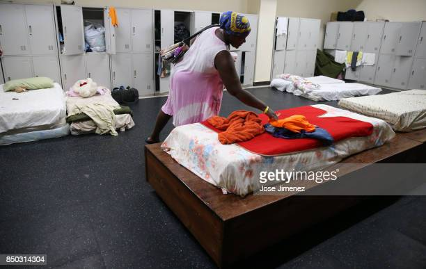 Jackeline Deazle resident of Barbuda whose house lost the roof and windows tends to a bed at a shelter in the Sir Vivian Richards Cricket Stadium on...