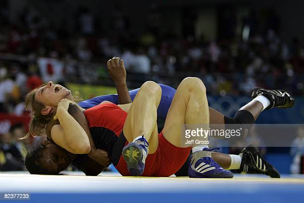 Jackeline Renteria of Colombia competes against Ana Paval of Romania in the women's 55kg freestyle wrestling event held at the China Agriculture...