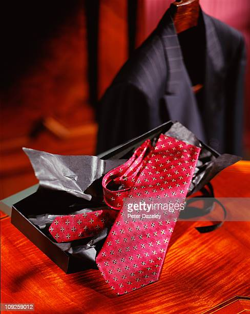 Jacket and tie on bedside table