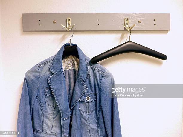Jacket Hanging On Hook Against Wall At Home