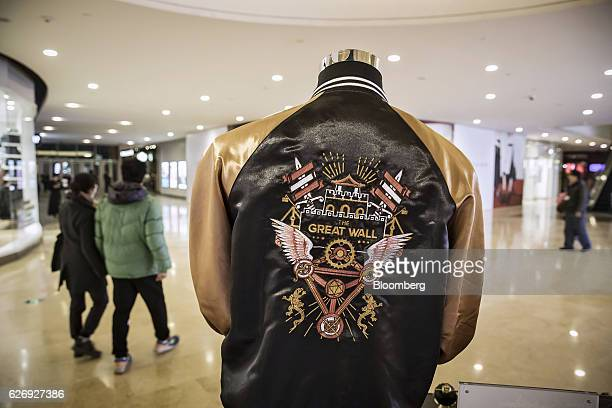 A jacket with a logo from the movie 'The Great Wall' is displayed at an Mtimecom Inc kiosk in Beijing China on Thursday Nov 24 2016 Mtime the movie...