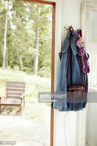 Jackets and camera hanging near door