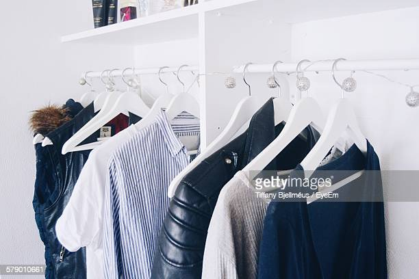 Jackets And T-Shirts Hanging On Clothes Rack