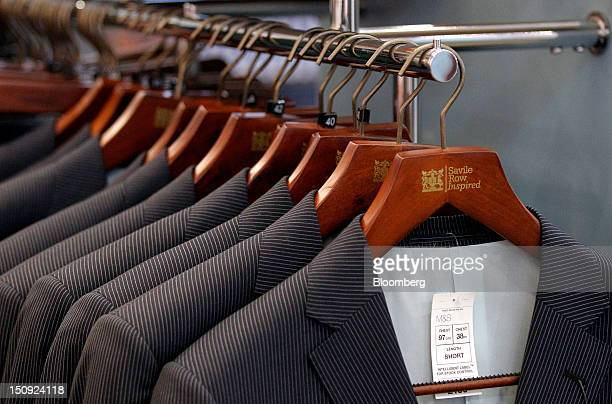 Jackets from the ''Savile Row Inspired'' collection hang on display at the new Marks Spencer Group Plc store in Chester UK on Wednesday Aug 29 2012...