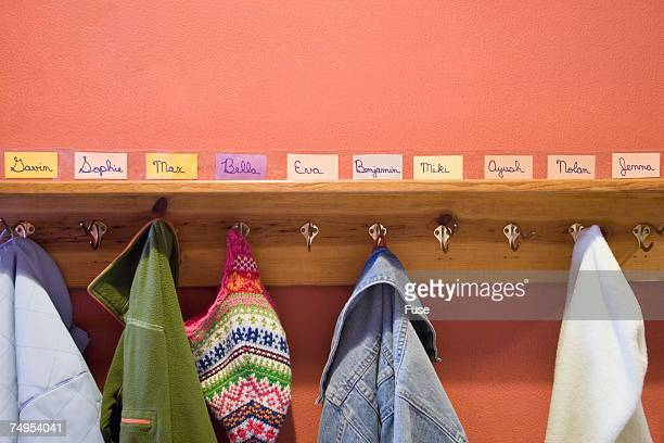 Jackets hanging from hooks