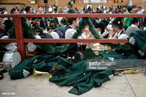 Jackets lie next to members of a traditional marching band at the traditional tent after the Parade of Costumes and Riflemen on the second day of the...