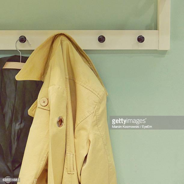 jackets on hanging on hook and coathanger - coat stock pictures, royalty-free photos & images