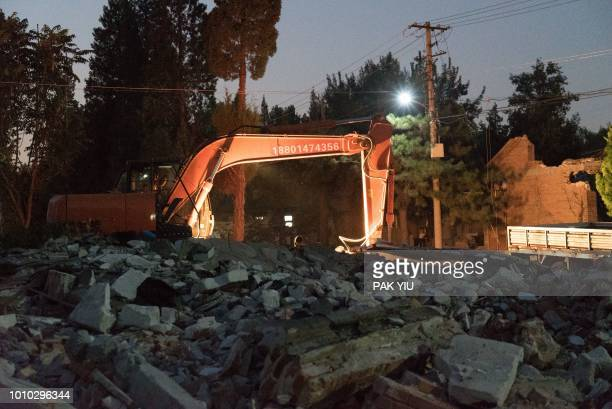 A jackhammer is seen beside rubble at artist Ai Weiwei's Left and Right Art Studio in Beijing on August 3 2018 Ai Weiwei said on August 3 2018...