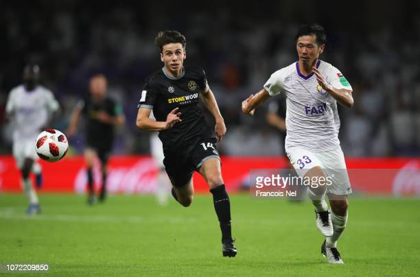 JackHenry Sinclair of Team Wellington and Tsukasa Shiotani of Al Ain chase the ball during the FIFA Club World Cup first round playoff match between...
